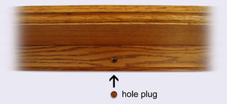Close up of wood Country Shelf holes and plugs